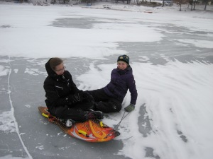 My daughter and a friend sledding on the ice